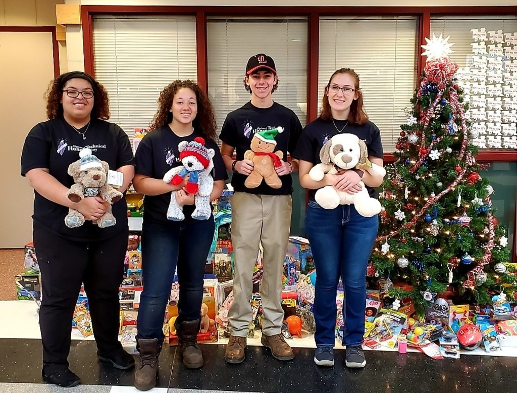 NTHS Officers hold stuffed animals for Toys for Tots