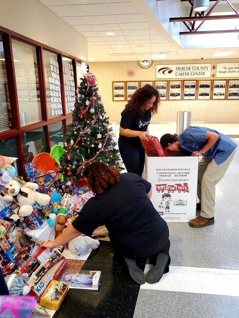 NTHS officer pack donated gifts for Toys for Tots