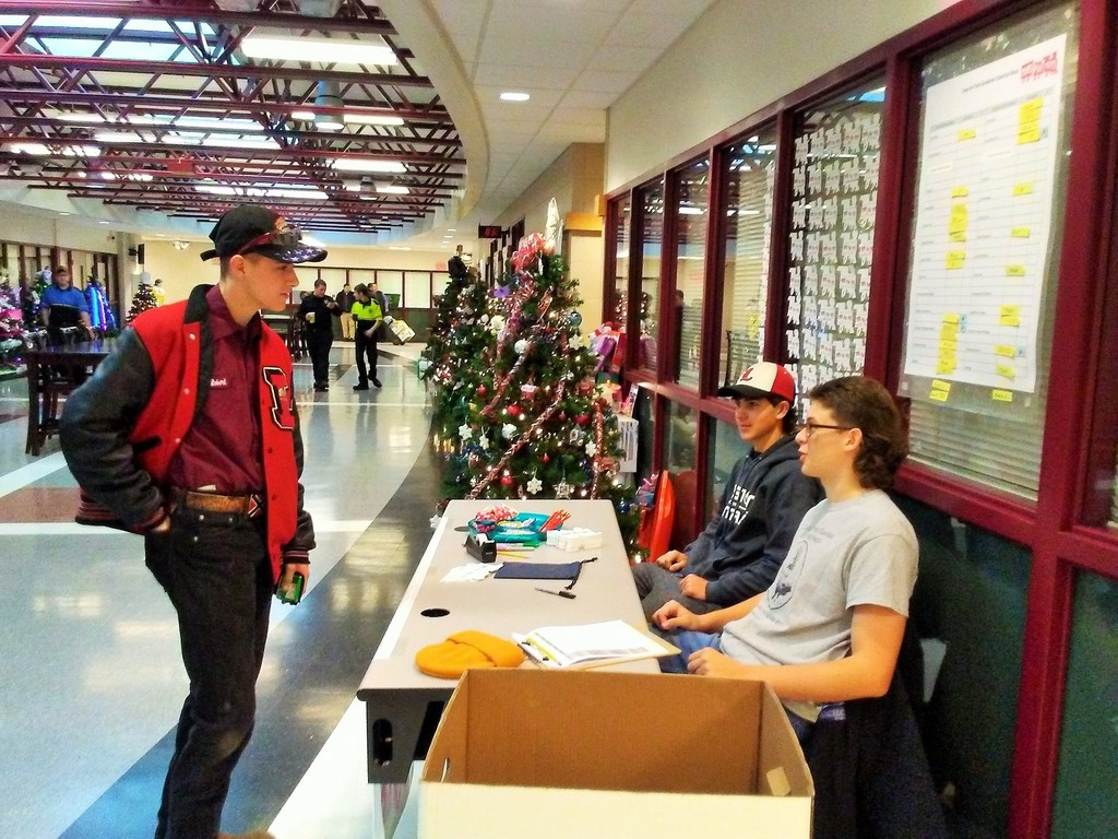 NTHS members man the Toys for Tots display to accept gifts.